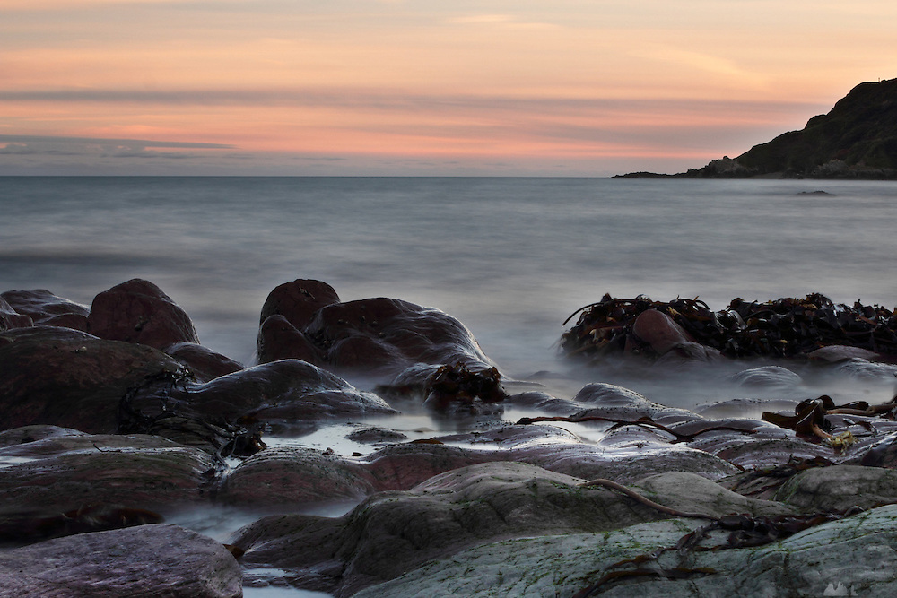 Long exposure images of Talland Bay at dusk, near Looe, southern Cornwall