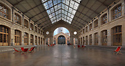 1 of the 2 main halls, built 1870-74 with a cast iron frame, as a municipal undertakers, at Le Centquatre Paris, now a public arts space opened in October 2008 on the rue d'Aubervilliers, in the 19th arrondissement of Paris, France. The 104 space features screening rooms, event spaces, exhibition spaces and office space. It is used for performing arts, audiovisual arts, theatre and dance, with shows, concerts, exhibitions and classes, markets and pop-ups, with the public welcome. Picture by Manuel Cohen