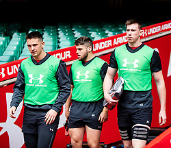 Owen Watkin of Wales with Nicky Smith and Adam Beard<br /> <br /> Photographer Simon King/Replay Images<br /> <br /> Six Nations Round 3 - Captains Run - Wales v England - Saturday 22nd February 2019 - Principality Stadium - Cardiff<br /> <br /> World Copyright © Replay Images . All rights reserved. info@replayimages.co.uk - http://replayimages.co.uk