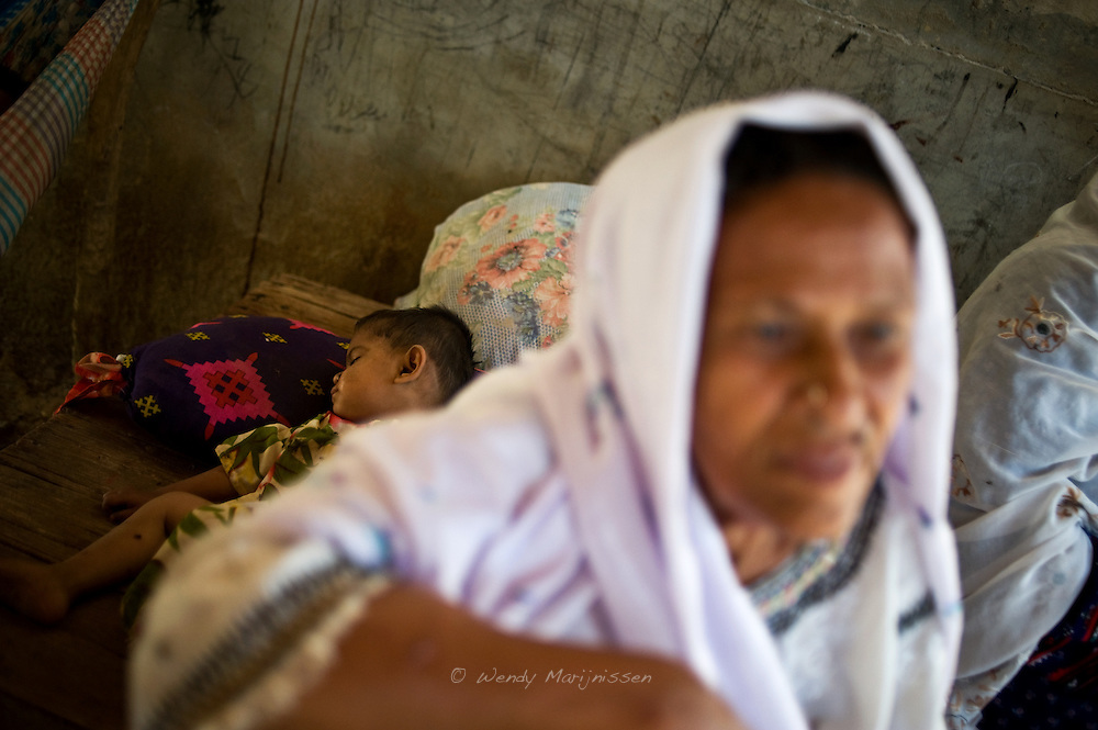 One of the many grandchildren of Sherbano takes an afternoon nap. Rehri Goth, Karachi, Pakistan, 2011