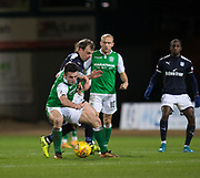 24th January 2018, Dens Park, Dundee, Scottish Premiership, Dundee versus Hibernian; Hibernian's John McGinn shields the ball from Dundee's Paul McGowan