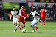 Southampton's Adam Lallana &copy; breaks past Swansea's Dwight Tiendalli. Barclays Premier league match, Swansea city v Southampton at the Liberty stadium in Swansea, South Wales on Saturday 3rd May 2014.<br /> pic by Andrew Orchard, Andrew Orchard sports photography.