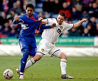 Photo: Daniel Hambury.<br />Crystal Palace v Leeds United. Coca Cola Championship. 04/03/2006.<br />Palace's Mikele Leigertwood (L) and Leeds' David Healy battle.