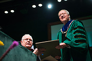 "President Emeritus Charles Ping (Left) presented the charter of Ohio University to Dr. Nellis, reminding him, ""Possession of this charter identifies you, as it did each of your 20 predecessors, as the steward of the University's past, and the architect of its future."""