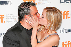 Actress AMBYR CHILDERS plants a huge kiss on producer RANDALL EMMETT at the 'End Of Watch' Premiere during the 2012 Toronto International Film Festival at The Roy Thomson Hall, Saturday September 8th, 2012. Photo by David Tabor/i-Images.