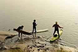 © Licensed to London News Pictures. 10/09/2014. Newnham, Gloucestershire, UK.  Surfers and kayakers get ready to ride this morning's Severn Bore at Newnham. Photo credit : Simon Chapman/LNP
