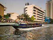 "28 JANUARY 2015 - BANGKOK, THAILAND: Passengers on the Khlong Saen Saeb water taxis. The boats, called ""khlong taxis"" are really more like buses because they run a specific route and stop at specific piers on a regular schedule. Khlong Saen Saeb was dug in the 19th century to move Siamese (Thai) troops and supplies to the Khmer (Cambodian) border during a Siamese war against the Annamese (southern Vietnamese). After months of relative calm following the May 2014 coup, tensions are increasing in Bangkok. The military backed junta has threatened to crack down on anyone who opposes the government. Relations with the United States have deteriorated after Daniel Russel, the US Assistant Secretary of State for Asian and Pacific Affairs, said that normalization of relations between Thailand and the US would depend on the restoration of a credible democratically elected government in Thailand.     PHOTO BY JACK KURTZ"