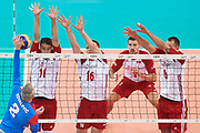 Poland, Warsaw - 2017 August 24: (L-R) Fabian Drzyzga and Lukasz Wisniewski and Bartosz Kurek all from Poland block against Uros Kovacevic from Serbia during LOTTO EUROVOLLEY POLAND 2017 - European Championships in volleyball at Stadion PGE Narodowy on August 24, 2017 in Warsaw, Poland.<br /> <br /> Mandatory credit:<br /> Photo by &copy; Adam Nurkiewicz<br /> <br /> Adam Nurkiewicz declares that he has no rights to the image of people at the photographs of his authorship.<br /> <br /> Picture also available in RAW (NEF) or TIFF format on special request.<br /> <br /> Any editorial, commercial or promotional use requires written permission from the author of image.