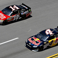 April 17, 2011; Talladega, AL, USA; NASCAR Sprint Cup Series driver Tony Stewart (14) and Kasey Kahne (4) during the Aarons 499 at Talladega Superspeedway.   Mandatory Credit: Derick E. Hingle
