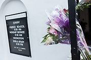 Floral tributes on a gate at the Mother Emanuel African Methodist Episcopal Church on the 2nd anniversary of the mass shooting June 17, 2017 in Charleston, South Carolina. Nine members of the historic African-American church were gunned down by a white supremacist during bible study on June 17, 2015.