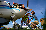 Jay and his colleague Mike perform maintenance on the 206. Both live in Arua and run the AIM Air Uganda outpost.