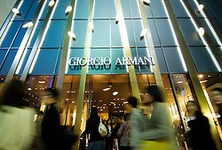 Evening view of shop front of new Giorgio Armani Tower in Ginza Tokyo