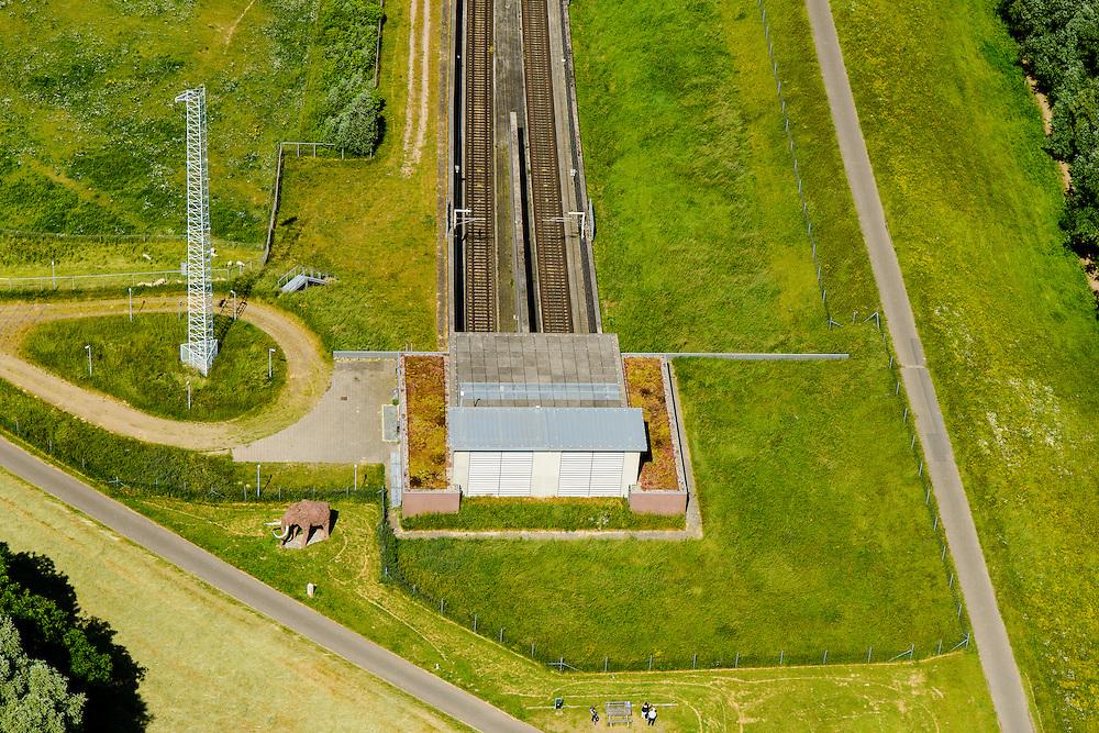 Nederland, Gelderland, Duiven, 09-06-2016; Groessen, natuurgebied Kandia. Betuweroute, tunnel onder Pannerdensch kanaal. Naast het dienstgebouw van de tunnel  De Mammoet (Kunstenaar Joris Baudoin).<br /> Tunnel Betuweroute, freight railway, Pannerdensch kanaal - Pannerdens channel (Lower Rhine) on the horizon.<br /> <br /> luchtfoto (toeslag op standard tarieven);<br /> aerial photo (additional fee required);<br /> copyright foto/photo Siebe Swart