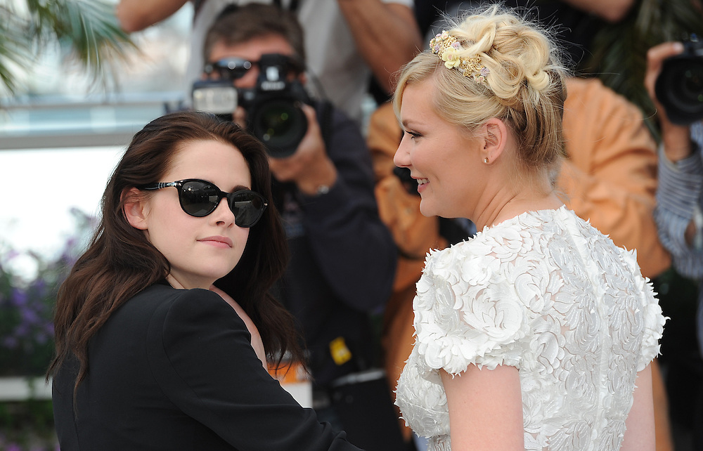 Actresses Kristen Stewart (L) and Kirsten Dunst during the 65th Annual Cannes Film Festival at Palais des Festivals on May 23, 2012 in Cannes, France..Photo Ki Price.
