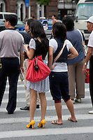 two women about to cross road in Shanghai China