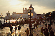Santa Maria della Salute at the entrance of Canale Grande, seen from Riva degli Schiavoni at sunset.