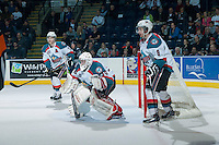 KELOWNA, CANADA - APRIL 3: Jordon Cooke #30 of the Kelowna Rockets defends the net against the Seattle Thunderbirds on April 3, 2014 during Game 1 of the second round of WHL Playoffs at Prospera Place in Kelowna, British Columbia, Canada.   (Photo by Marissa Baecker/Getty Images)  *** Local Caption *** Jordon Cooke; Damon Severson; Colten Martin;