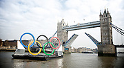 Mayor launches giant Olympic rings onto the River Thames <br /> <br /> 28th February 2012<br /> <br /> River Thames near Tower Bridge and City Hall, London, Great Britain <br /> <br /> <br /> Photograph by Elliott Franks