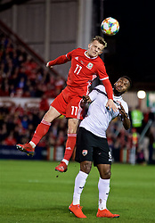 WREXHAM, WALES - Wednesday, March 20, 2019: Wales' George Thomas and Trinidad and Tobago's Khaleem Hyland during an international friendly match between Wales and Trinidad and Tobago at the Racecourse Ground. (Pic by David Rawcliffe/Propaganda)