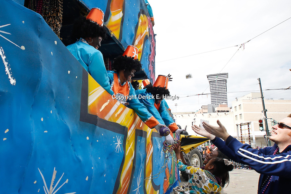 February 21, 2012; New Orleans, LA, USA; Riders throw from a float during the Krewe of Zulu parade as it rolled along the uptown New Orleans St. Charles Avenue parade route throwing beads, painted coconuts and various trinkets on Mardi Gras day. Mardi Gras is an annual celebration that ends at midnight with the start of the Catholic Lenten season which begins with Ash Wednesday and ends with Easter. Photo by: Derick E. Hingle