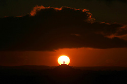 © Licensed to London News Pictures. 15/01/2016. Glastonbury, UK The sky lit up deep orange and red as sun sets behind Glastonbury Tor in the English county of Somerset. Photo credit : Jason Bryant/LNP