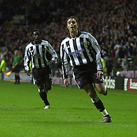 Photo. Glyn Thomas.Digitalsport<br /> Newcastle United v Tottenham Hotspur. FA Barclaycard Premiership. St James' Park, Newcastle. 13/12/2003.<br /> Newcastle's Laurent Robert celebrates scoring his second spectacular goal of the match and Titus Bramble (L) shares his joy.