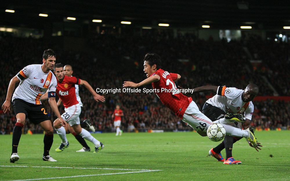 19th September 2012 - UEFA Champions League (Group H) - Manchester United vs. Galatasaray - Shinji Kagawa of Man Utd flies over a challenge from Dany Nounkeu of Galatasaray - Photo: Simon Stacpoole / Offside.