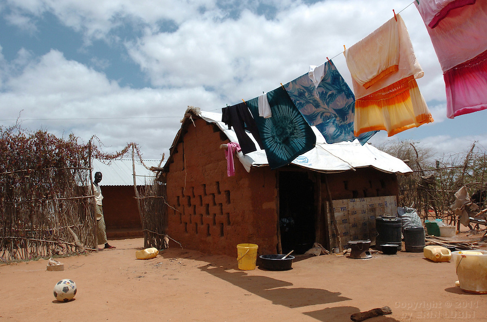 Clothes hang to dry in the courtyard of a family's home in Ifo Refugee Camp in Dadaab, Kenya, September 15, 2006. ..Photograph by Erin Lubin