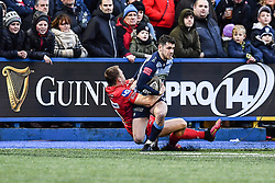 Cardiff Blues' Tomos Williams is tackled by Scarlets' Tom Prydie - Mandatory by-line: Craig Thomas/Replay images - 31/12/2017 - RUGBY - Cardiff Arms Park - Cardiff , Wales - Blues v Scarlets - Guinness Pro 14