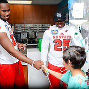 North Carolina State Wolfpack players visit the Providence Children's Hospital during the week of events for the 84th Annual Hyundai Sun Bowl. December 26, 2017