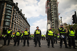 © Licensed to London News Pictures. 14/07/2018. London, UK. PICTURED: police block Westminster Bridge . Supporters of EDL founder Tommy Robinson ( real name Stephen Yaxley-Lennon ) and US President Donald Trump and anti fascists clash on Westminster Bridge during a day of demonstrations and rallies in support and opposed to US President Donald Trump and jailed EDL founder Tommy Robinson . Trump is currently in Scotland and Robinson is in HMP Hull . Photo credit: Joel Goodman/LNP