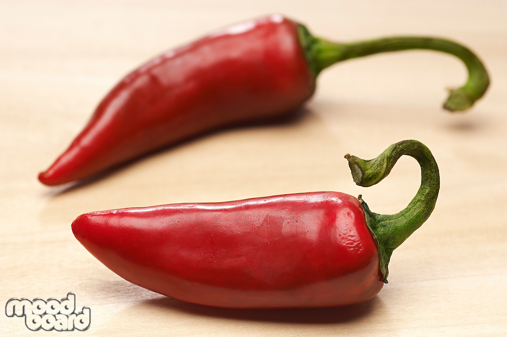 Two red chili peppers, close-up