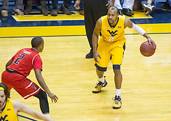 Feb 18, 2017; Morgantown, WV, USA; West Virginia Mountaineers guard Jevon Carter (2) dribbles the ball while guarded by Texas Tech Red Raiders guard Devon Thomas (2) during the first half at WVU Coliseum. Mandatory Credit: Ben Queen-USA TODAY Sports