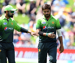 Pakistan's Rumman Raees, right, after dismissing New Zealand's Colin Munro for 34 in the fifth one day International Cricket match, Basin Reserve, Wellington, New Zealand, Friday, January 19, 2018