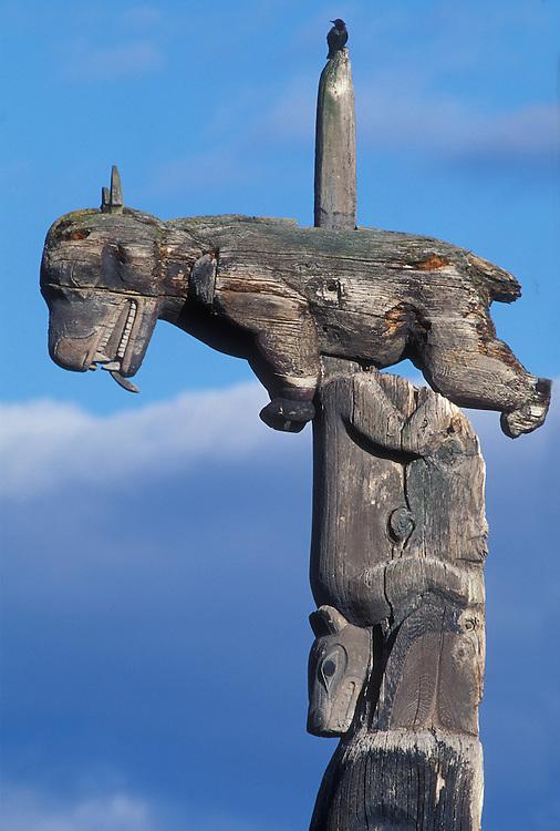 Canada, British Columbia, Totem poles depicting bear in village of Gitwangak just south of Kitwanga
