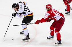 Constantin Braun of Germany vs Jesper Jensen of Denmark during ice-hockey match between Denmark and Germany of Group E in Qualifying Round of IIHF 2011 World Championship Slovakia, on May 7, 2011 in Orange Arena, Bratislava, Slovakia. Denmark defeated Germany 4-3 after overtime and shootout. (Photo By Vid Ponikvar / Sportida.com)