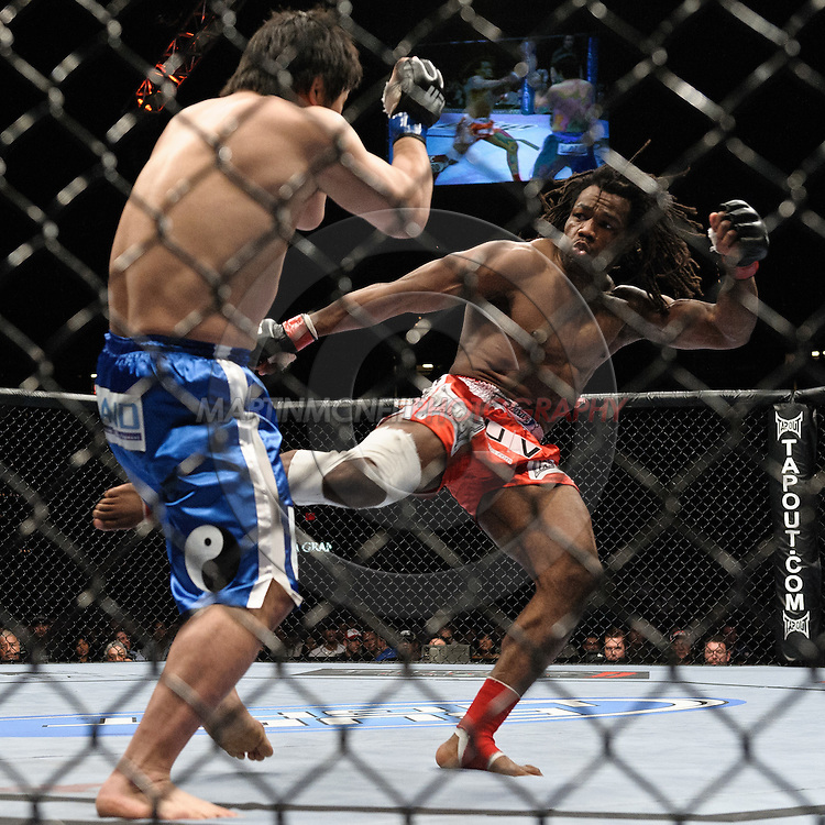 """LAS VEGAS, NEVADA, MAY 24, 2008: Kazuhiro Nakamura (left) steps back from a kick thrown by Thierry Rameau Sokoudjou during """"UFC 84: Ill Will"""" inside the MGM Grand Garden Arena in Las Vegas"""