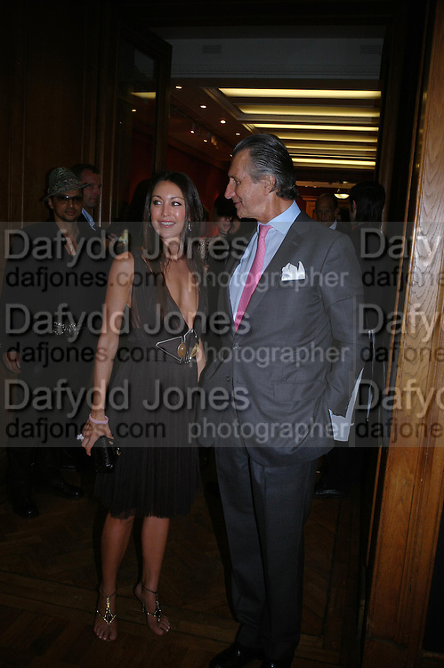 Tamara Mellon and Arnaud Bamberger. 4 Inches, A  Photographic Auction in aid of the Elton John Aids Foundation hosted by Tamara Mellon and Arnaud Bamberger. Christie's. 8 King St. London. 25 May 2005. ONE TIME USE ONLY - DO NOT ARCHIVE  © Copyright Photograph by Dafydd Jones 66 Stockwell Park Rd. London SW9 0DA Tel 020 7733 0108 www.dafjones.com