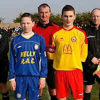 Match Officials & Captain's<br />Back: Julian Stanford (Linesman) Albert Murphy (Referee) Jim Denieffe (Linesman)<br />Front: Steven McGann (Ennis Town) & Donal O'Halloran (Avenue United)<br />Photograph by Flann Howard
