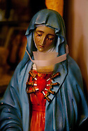 WORCESTER, MASSACHUSETTS:  A statue of the Virgin Mary appears to weep oil, on August 10, 2002, in the bedroom of Audrey Marie Santo as she lies in a coma a few feet away in her home in Worcester, MA. On August 9, 1987, when she was 3, she nearly drowned in her grandmother's swimming pool. An overdose of Phenobarbital at the hospital resulted in a coma like state called Akinetic Mutism. Unable to move (except for fingers and eyes) Little Audrey remains on life support at home. It has also been claimed that Audrey sometimes bore the stigmata. Audrey's parents claimed miracles in the home including icons weeping blood or oil, a bleeding statue of Jesus, consecrated hosts bleeding, blood appearing spontaneously in a tabernacle, oil dripping down the walls of the garage, and the Virgin Mary appearing in cloud formations overhead. Audrey Santo died from cardio-respiratory failure on April 14, 2007 in her home. (Photo by Robert Falcetti). .