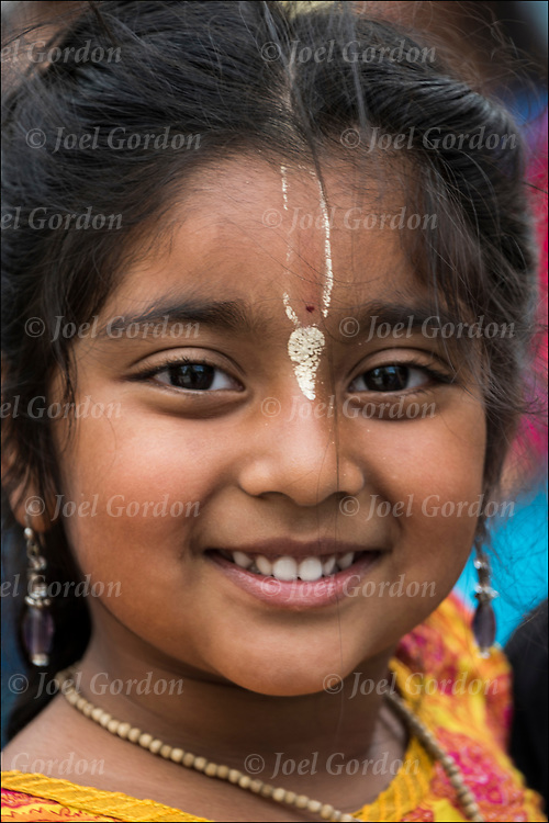 Portrait of smiling young girl devotee at the Hare Krishna Festival of Chariot, in Washington Square Park in NYC.<br /> <br /> This brand of Hinduism the movement revere their God, Krishna.