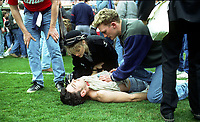 A Liverpool Fan recieves First Aid<br />The Tragic FA Cup Semi Final between Liverpool Vs Nottingham Forest where Sadly 96 Liverpool fans lost their lives because of Overcrowding at the Hillsborough Stadium Sheffiled 15th April 1989<br />PHOTO ROBIN PARKER FOTOSPORTS INTERNATIONAL