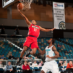RENO, NV - JANUARY 10:  Courtney Pigram #11 of the Maine Red Claws shoots a fast break layup ahead of defender Dontell Jefferson #11 of the Sioux Falls Skyforce during the 2012 NBA D-League Showcase inside the Reno Events Center in Reno, Nev., Tuesday, Jan. 10, 2012.  NOTE TO USER: User expressly acknowledges and agrees that, by downloading and or using this photograph, User is consenting to the terms and conditions of the Getty Images License Agreement. Mandatory Copyright Notice: Copyright 2012 NBAE  (Photo by David Calvert/NBAE via Getty Images) *** Local Caption *** Courtney Pigram;Dontell Jefferson