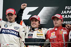 SHIZUOKA, JAPAN - Sunday, October 12, 2008: Fernando Alonso celebrates winning the Japanese Grand Prix with  Kimi Raeikkoenen (R) and Robert Kubica (L) during the Japanese Formula One Grand Prix at the Fuji Speedway. (Photo by Michael Kunkel/Hochzwei/Propaganda)