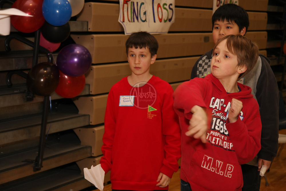Paper airplane challenge at HIMS Carnival Night 2010 - 6th graders Tommy Renelaan, Asher Baden, and William Takano