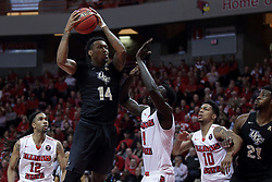 "20 March 2017:   Nick Banyard elevates over Daouda ""David"" Ndiaye (4) during a College NIT (National Invitational Tournament) 2nd round mens basketball game between the UCF (University of Central Florida) Knights and Illinois State Redbirds in  Redbird Arena, Normal IL"