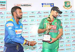 April 6, 2017 - Colombo, Sri Lanka - Sri Lanka's cricket captain Upul Tharanga (L) and Bangladesh's cricket captain Mashrafe Mortaza walk away after posing with the series trophy after the second T20 international cricket match between Sri Lanka and Bangladesh at the R Premadasa Stadium in Colombo on April 6, 2017. Bangladesh beat Sri Lanka by 45 runs in the second Twenty20 international to finish the two-match series with a draw in Colombo. (Credit Image: © Tharaka Basnayaka/NurPhoto via ZUMA Press)