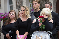 © Licensed to London News Pictures. 29/07/2016. Brighton, UK. Funeral of Sam Caulfield 20 from Mayfield who was stabbed in a flat in Crawley on the 8th of August 2016. Funeral was at Woodvale Crematorium, Lewes Road, Brighton. Girlfriend Hayley Hillyer shows her emotion. Photo credit: Grant Melton/LNP