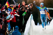 Daniel Pfister, AUT, waves to the crowd after finishing his fourth run of the Men's Single Luge competition during the 2010 Vancouver Winter Olympics at the Whistler Sliding Centre in Whistler, British Columbia, Sunday, Feb. 14, 2010. Pfister finished in sixth place.