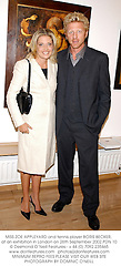 MISS ZOE APPLEYARD and tennis player BORIS BECKER, at an exhibition in London on 26th September 2002.PDN 10